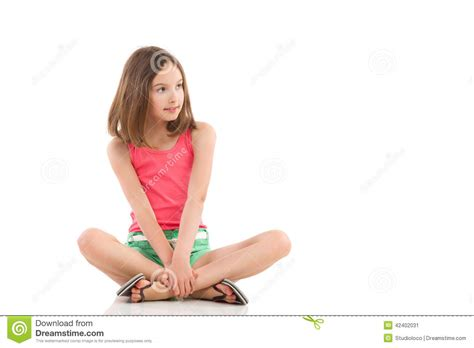 young crossbreed pensive girl sitting with legs crossed stock image image