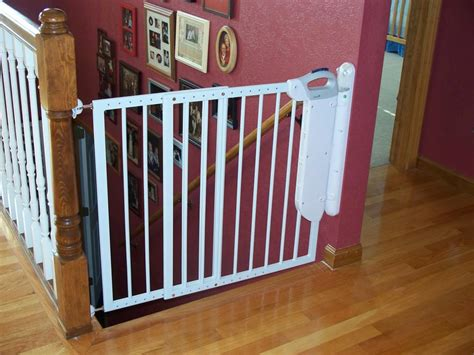 top of stairs baby gate with banister stairway safety doors image of stair gates wooden idea