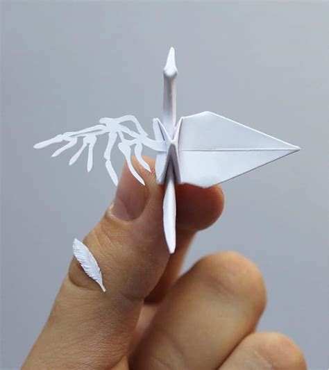 Origami Paper Cutting - paper artist creates 1000 elaborate origami cranes and
