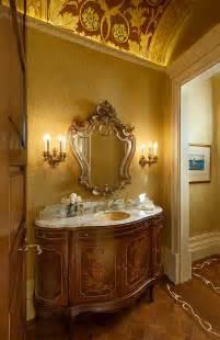 Splash of yellow for the mediterranean powder room design giffin