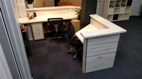 white washed desk made white washed reclaimed wood and steel reception