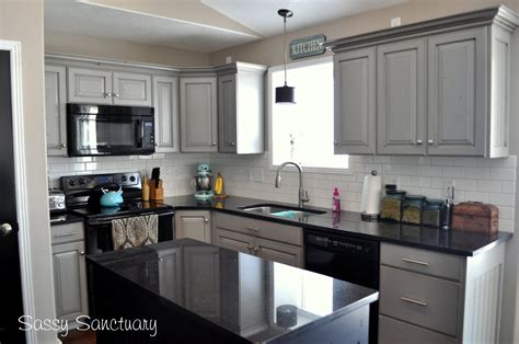 gray painted cabinets with black countertops light grey kitchen cabinets with dark countertops