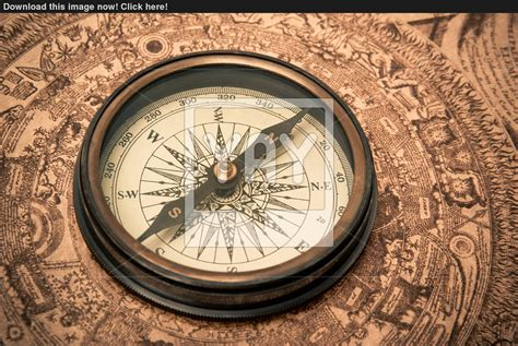 antique compass on map image yayimages com