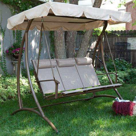 x swing brown steel patio swing with three broken white seat