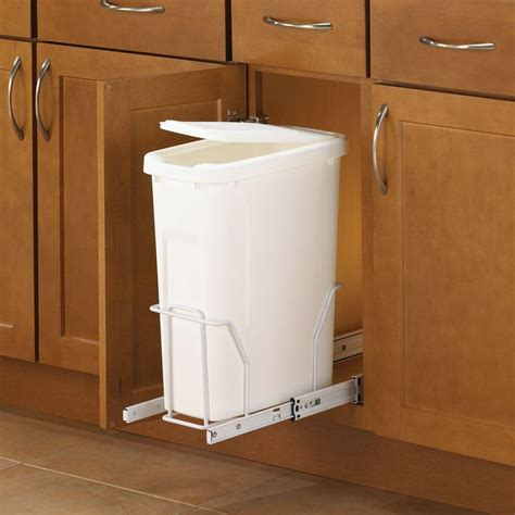 pull out trash cans under cabinet under cabinet trash can hertco garbage can trash door