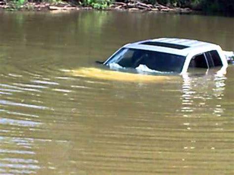 man drives ford truck in kaskaskia river. wipers still on