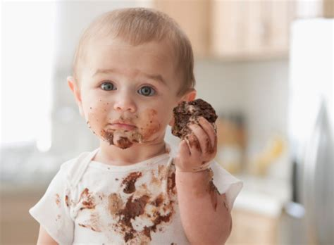 messy hispanic baby eating cake stock photo   getty images