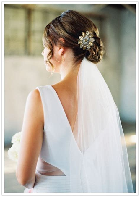 hairstyles to the side with veil wedding hair style low bun veil underneath clip