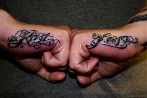 finger tattoos men designs small side arrow for