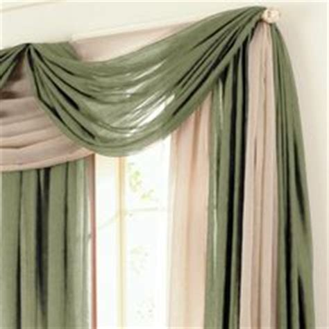 how to hang a swag scarf curtain 1000 images about ways to hang a scarf valance on