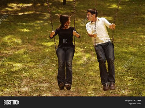 2 couples swinging love couple swing park playground stock photo stock