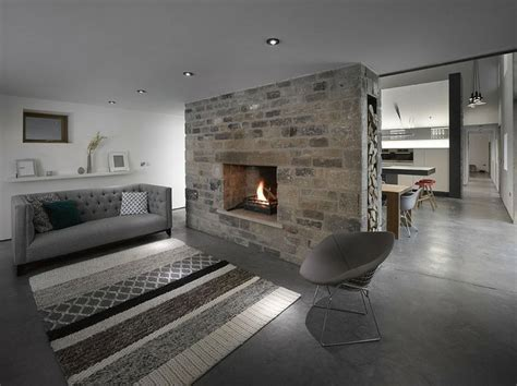 concrete living room floor eclectic living room with stone fireplace concrete