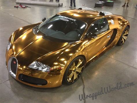 bugatti wheels gold definition of ghastly flo rida s gold chrome bugatti veyron