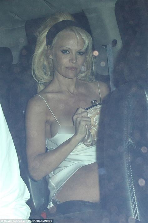 pamela wardrobe malfunction pamela anderson suffers wardrobe malfunction as her dress falls down daily mail online