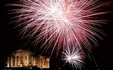 new year s celebrations around the world fireworks explode the ancient parthenon temple at the