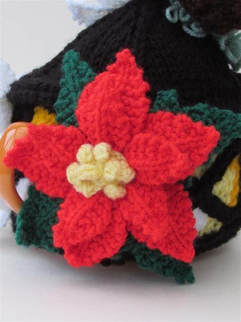 knitted poinsettia lantern tea cosy knitting pattern