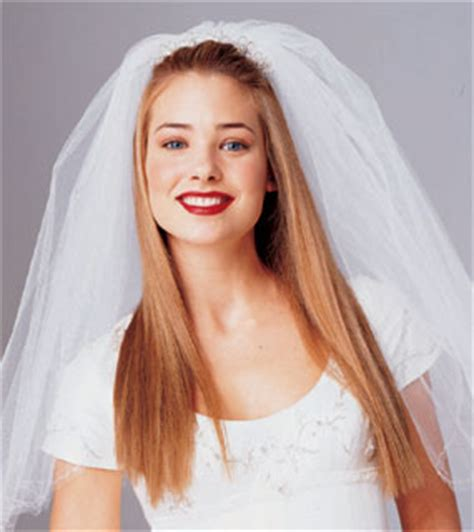 bride hairstyle with headpiece and veil, long hair, blond