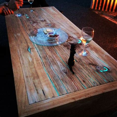 glow in the table macrocarpa timber slab coffee table with glow in the
