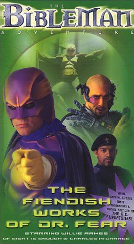 tv bibleman holds  garage sale  writing   wall