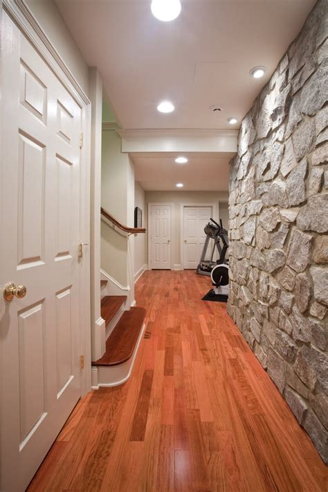 basement renovation  rustic stone walls idesignarch