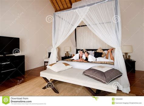 bedroom couple pic couple relaxing in bedroom stock photos image 13354093