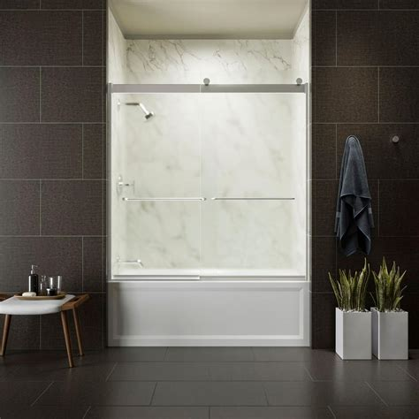 kohler frameless bathtub door kohler levity 59 in x 62 in semi frameless sliding tub door in silver finish with