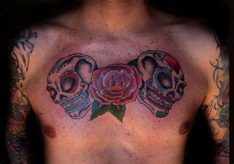 rose tattoo on chest meaning skull and roses tattoos designs ideas and meaning