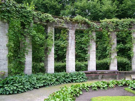 greek gardens arch arches overgrown garden bench column columns greek