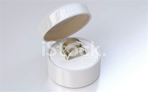 wedding rings in white jewelry box stock photos
