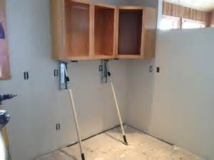 How To Install Kitchen Cabinets By Yourself Easy Cabinets Installation The Stand In The Greatest Cabinet Hanging Tool