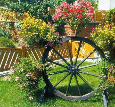 Wagon Wheel Planter Garden Ideas Pinterest Wagon Wheel Planter
