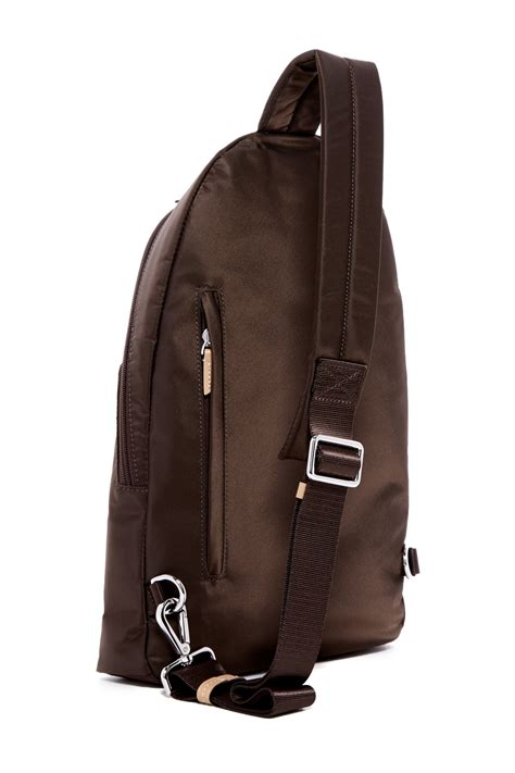 tumi luxor sling backpack in brown lyst
