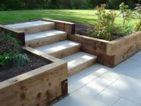 sleeper retaining walls and pavior capped steps garden