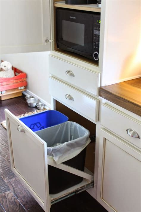 trash can attached to cabinet door 1000 ideas about light kitchen cabinets on