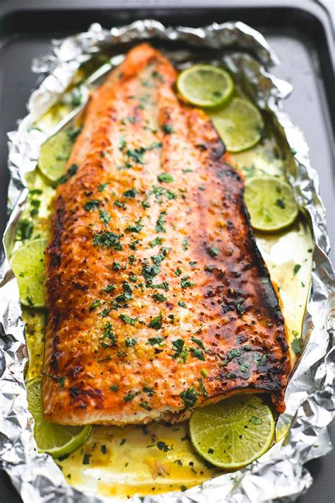 salmon in oven baked honey cilantro lime salmon in foil is cooked to tender flaky perfection in just 30