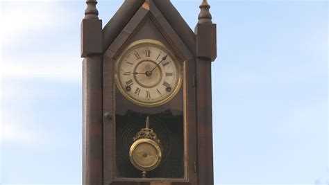 grandfather clock pendulum stops swinging low angle view of clock pendulum swinging includes high