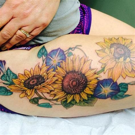 sunflower thigh tattoo 53 sunflower tattoos blossoms seeking out light