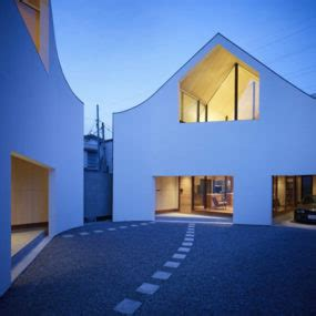 zen home design proves two is better than one modern slatted facade house with sleek adjoined apartment