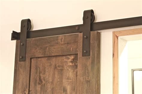 hanging a barn door a modern hanging barn door