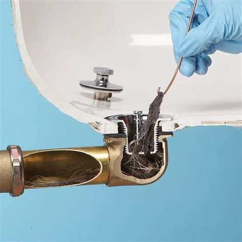 bathroom bathtub drain clogged gloves blue bathtub drain