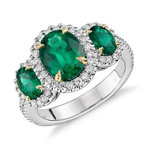 three emerald and halo ring in 18k white and