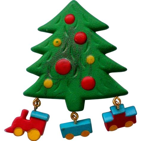 molded christmas tree pin with toy train from manorsfinest
