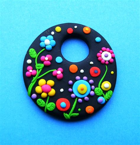 fimo clay fimo polymer clay necklace medallion flowers in the