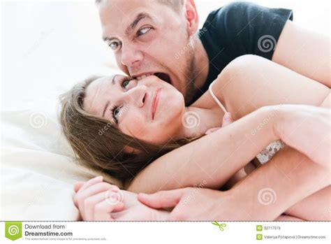 fun in bed lovely couple having fun on their bed royalty free stock