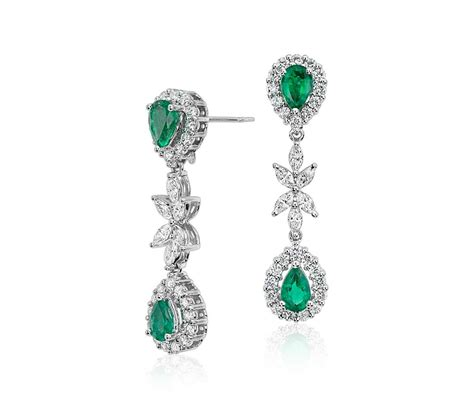 emerald and dangle earrings in 18k white gold