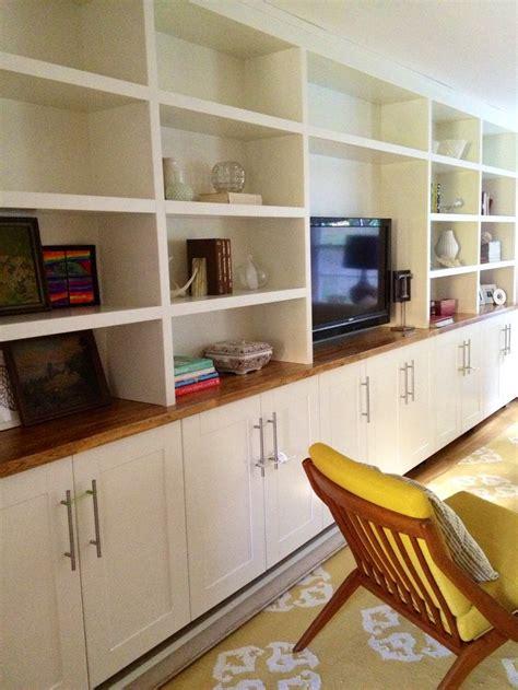 built ins ikea adel cabinets below custom shelving on