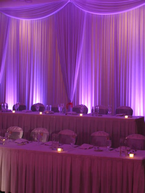 drapes and lights for weddings gorgeous head table backdrop with curtains and uplighting