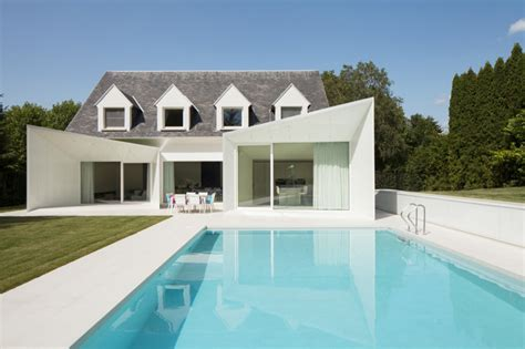 old modern black and white belgium house with modern sculptural additions