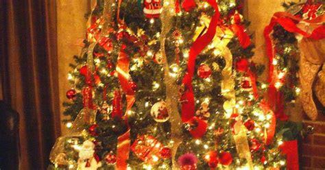 draping ribbon on christmas tree vertical ribbon draping with santa hat as tree topper