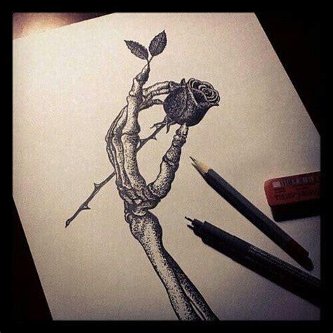 skeleton hand holding rose tatt sketch wild pinterest